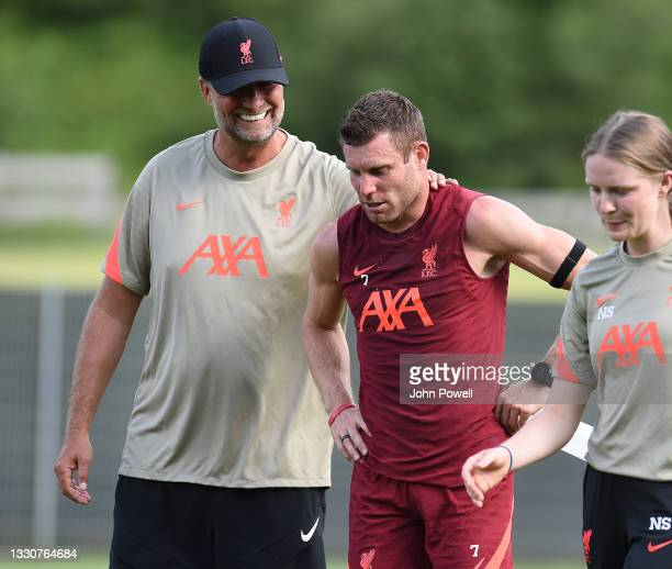 Jurgen Klopp manager of Liverpool with James Milner of Liverpool during a training session on July 26, 2021 in UNSPECIFIED, Austria.