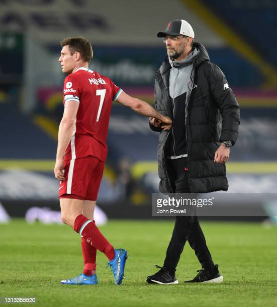 Jurgen Klopp manager of Liverpool with James Milner of Liverpool at the end of the Premier League match between Leeds United and Liverpool at Elland...