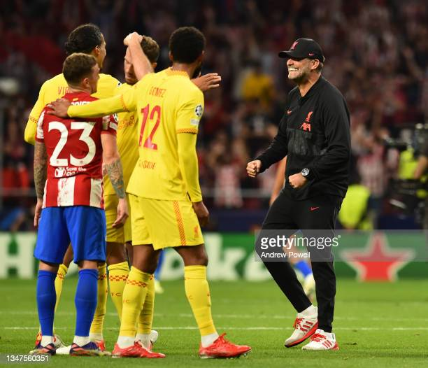 Jurgen Klopp manager of Liverpool with Joe Gomez of Liverpool and Virgil van Dijk of Liverpool at the end of the UEFA Champions League group B match...