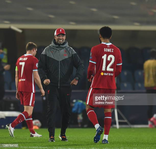 Jurgen Klopp manager of Liverpool with Joe Gomez of Liverpool at the end of the UEFA Champions League Group D stage match between Atalanta BC and...