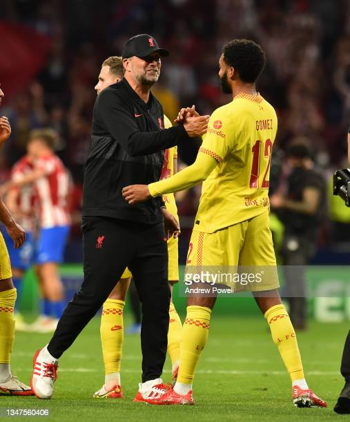 Jurgen Klopp manager of Liverpool with Joe Gomez of Liverpool at the end of the UEFA Champions League group B match between Atletico Madrid and...