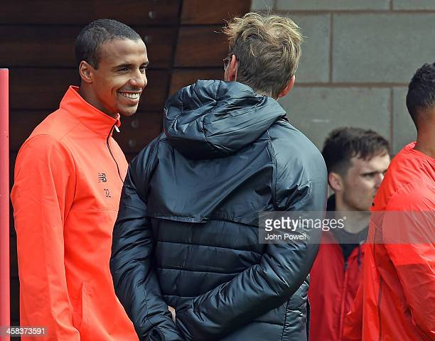 Jurgen Klopp manager of Liverpool with Joel Matip of Liverpool during the first day back at Training in Melwood Training Ground on July 2 2016 in...