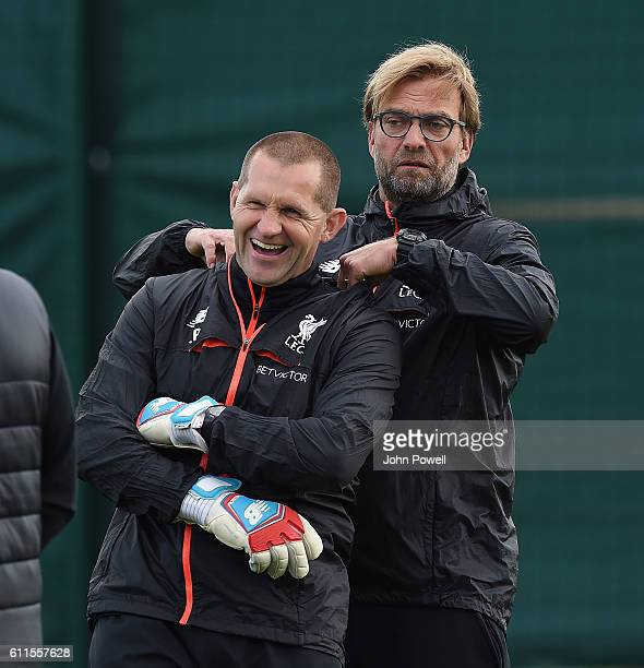 Jurgen Klopp manager of Liverpool with John Achterberg Firstteam goalkeeping coach during atraining session at Melwood Training Ground on September...