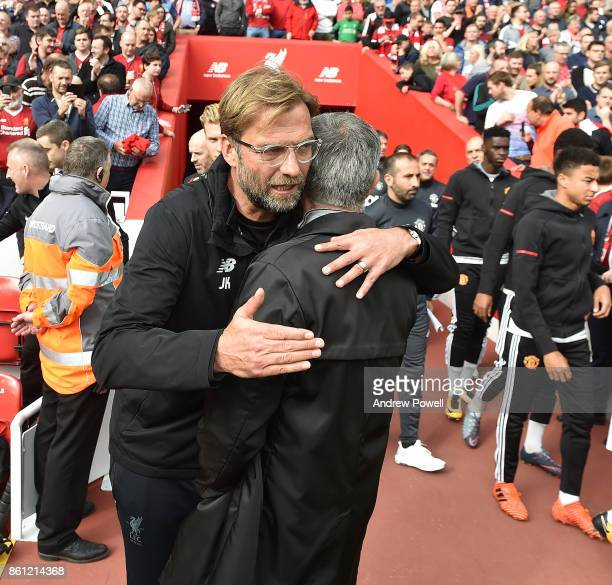 Jurgen Klopp Manager of Liverpool with Jose Mourinho Manager Manchester United during the Premier League match between Liverpool and Manchester...