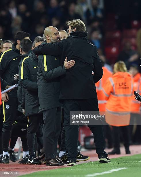 Jurgen KLopp Manager of Liverpool with Josep 'Pep' Guardiola at the end of the Premier League match between Liverpool and Manchester City at Anfield...