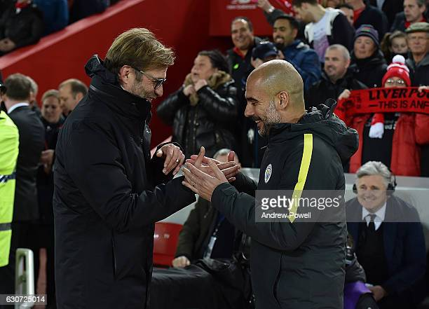 Jurgen KLopp Manager of Liverpool with Josep 'Pep' Guardiola during the Premier League match between Liverpool and Manchester City at Anfield on...