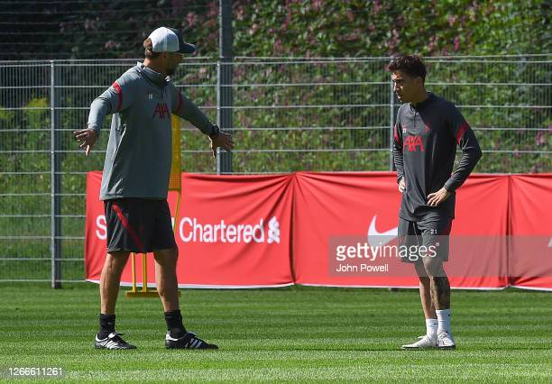 Jurgen Klopp manager of Liverpool with Kostas Tsimikas of Liverpool during a training session on August 16, 2020 in Salzburg, Austria.