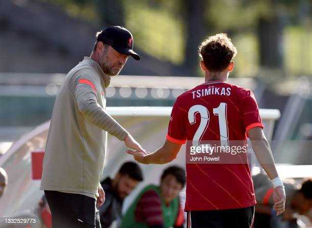 Jurgen Klopp manager of Liverpool with Kostas Tsimikas of Liverpool during the Pre Season match between Liverpool and Bologna on August 05, 2021 in...