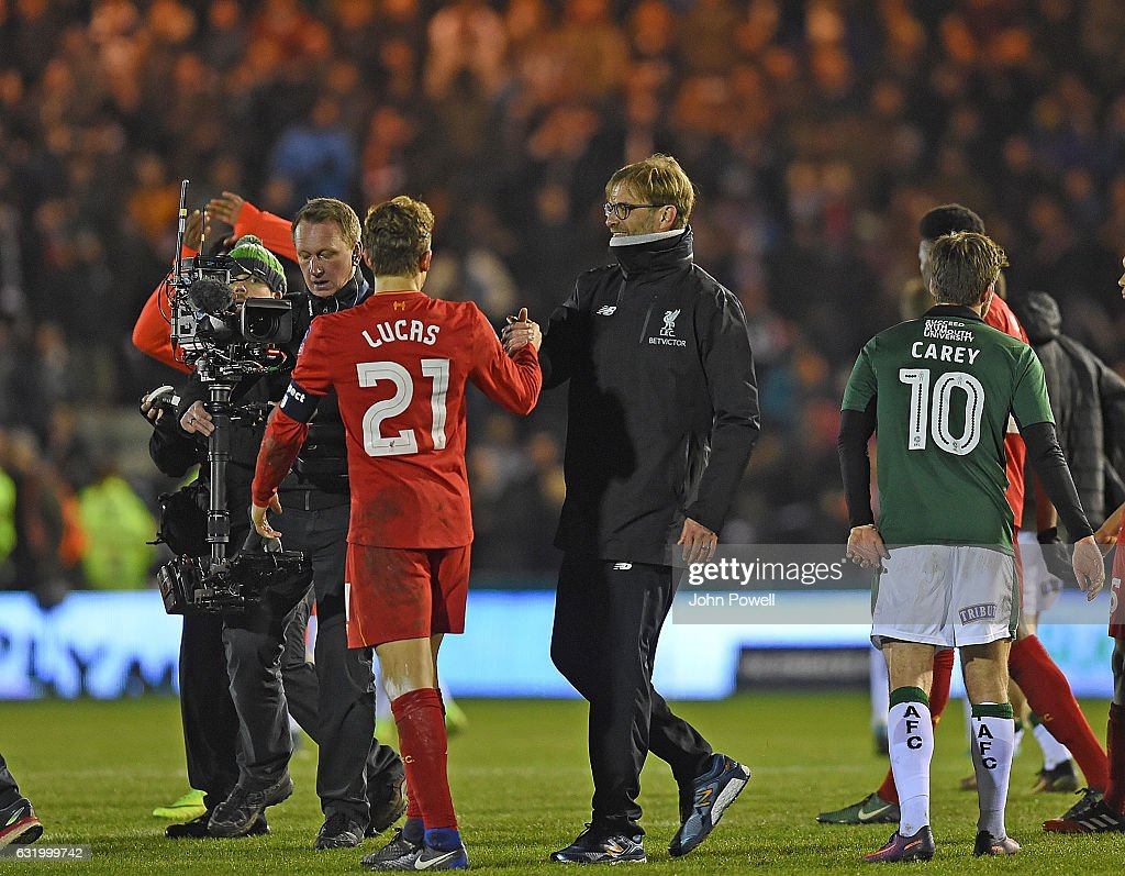 Jurgen Klopp Manager of Liverpool with Lucas Leiva at the end of the Emirates FA Cup Third Round replay match between Plymouth Argyle and Liverpool at Home Park on January 18, 2017 in Plymouth, England.