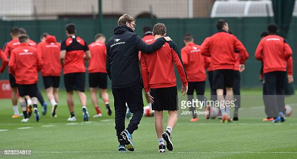 Jurgen Klopp manager of Liverpool with Lucas of Liverpool during a training session at Melwood Training Ground on April 22 2016 in Liverpool England