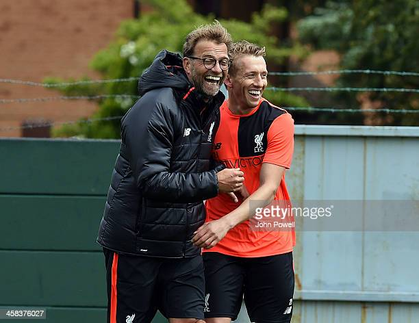 Jurgen Klopp manager of Liverpool with Lucas of Liverpool during the first day back at Training in Melwood Training Ground on July 2 2016 in...
