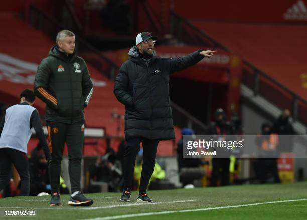 Jurgen Klopp manager of Liverpool with Manchester United manager Ole Gunnar Solskjaer during The Emirates FA Cup Fourth Round match between...