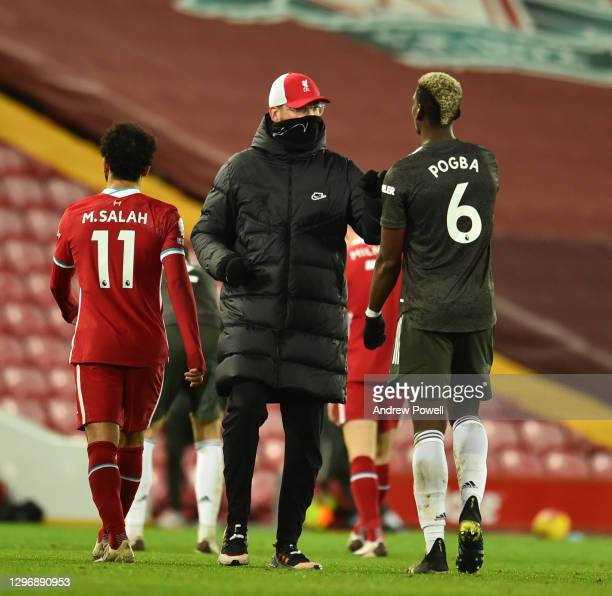 Jurgen Klopp manager of Liverpool with Manchester United's Paul Pogba during the Premier League match between Liverpool and Manchester United at...