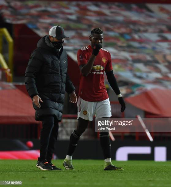 Jurgen Klopp manager of Liverpool with Manchester United's Paul Pogba at the end of the Emirates FA Cup Fourth Round match between Manchester United...