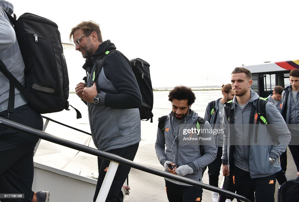Jurgen Klopp manager of Liverpool with Mohamed Salah and Jordan Henderson of Liverpool board the plane for their trip to Porto at Liverpool John Lennon Airport on February 13, 2018 in Liverpool, England.