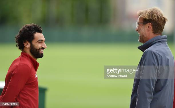 Jurgen Klopp manager of Liverpool with Mohamed Salah during a training session at Melwood Training Ground on September 7 2017 in Liverpool England