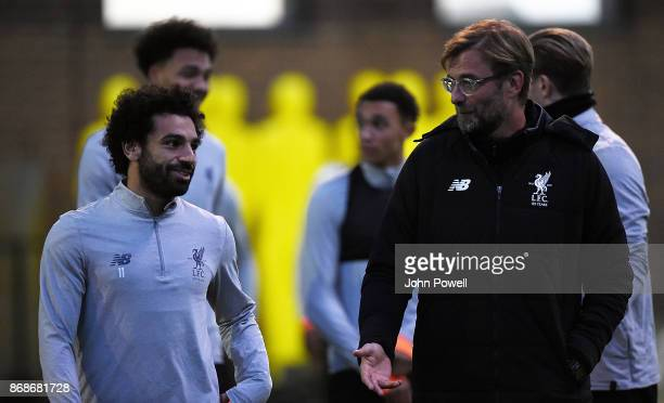 Jurgen Klopp manager of Liverpool with Mohamed Salah during a Liverpool training session at Melwood Training Ground on October 31 2017 in Liverpool...
