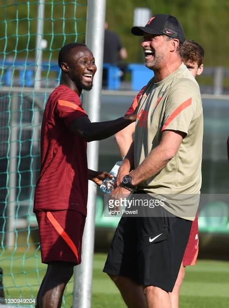 Jurgen Klopp manager of Liverpool with Naby Keita of Liverpool during a training session on July 27, 2021 in UNSPECIFIED, Austria.