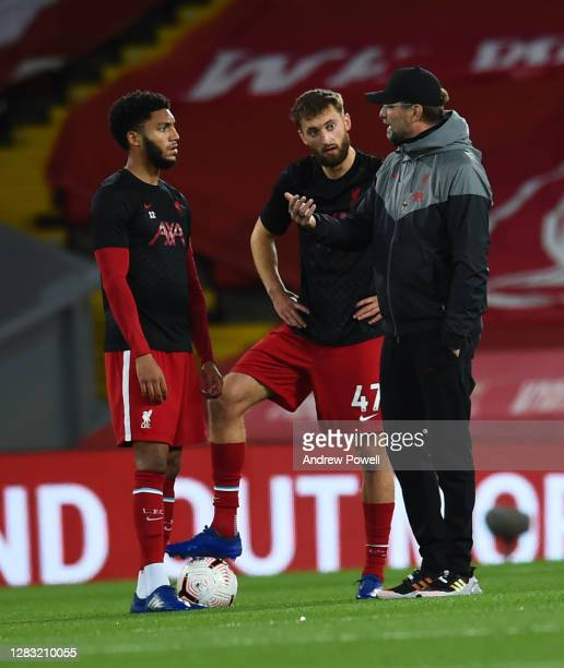 Jurgen Klopp manager of Liverpool with Nathaniel Phillips of Liverpool and Joe Gomez of Liverpool before the Premier League match between Liverpool...