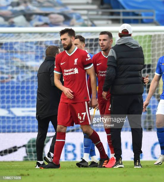Jurgen Klopp manager of Liverpool with Nathaniel Phillips of Liverpool at the end of the Premier League match between Brighton & Hove Albion and...