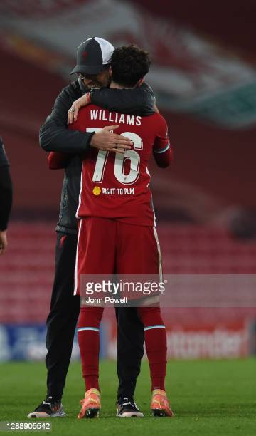 Jurgen Klopp manager of Liverpool with Neco Williams of Liverpool at the end of the UEFA Champions League Group D stage match between Liverpool FC...