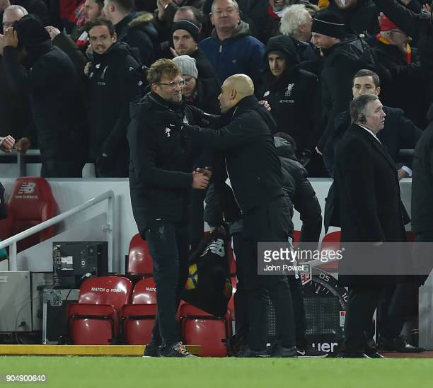 Jurgen Klopp Manager of Liverpool with pep guardiola Manager of Man City during the Premier League match between Liverpool and Manchester City at...