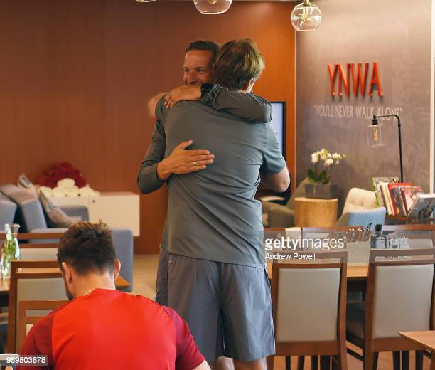 Jurgen Klopp manager of Liverpool with Pep Lijnders during their first day back for preseason training at Melwood Training Ground on July 2 2018 in...