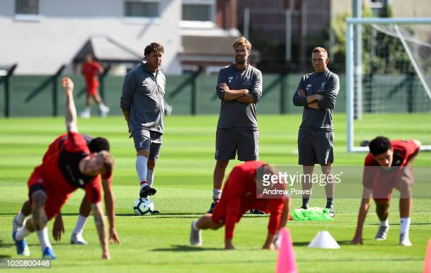 Jurgen Klopp manager of Liverpool with Peter Krawietz and Pepijn Lijnders of Liverpool during a training session at Melwood Training Ground on August...