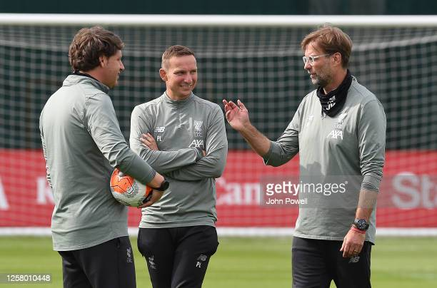 Jurgen Klopp manager of Liverpool with Peter Krawietz and Pepijn Lijnders of Liverpool during a training session at Melwood Training Ground on July...