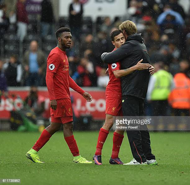 Jurgen Klopp Manager of Liverpool with Philippe coutinho And Daniel Sturridge at End of the Premier League match between Swansea City and Liverpool...