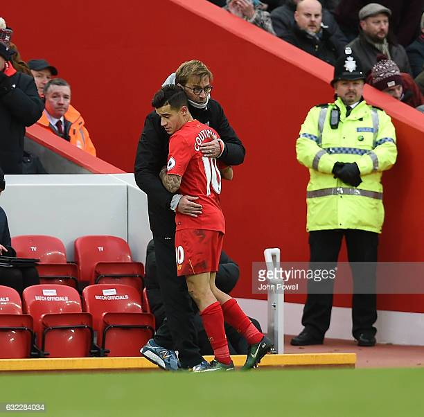 Jurgen Klopp manager of Liverpool with Philippe Coutinho during the Premier League match between Liverpool and Swansea City at Anfield on January 21...