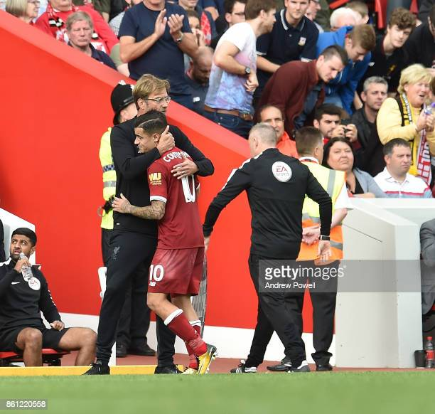 Jurgen Klopp manager of Liverpool with Philippe Coutinho during the Premier League match between Liverpool and Manchester United at Anfield on...