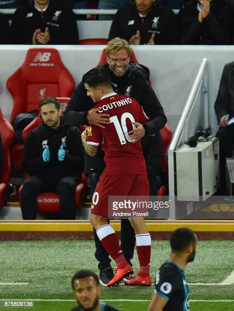 Jurgen Klopp manager of Liverpool with Philippe Coutinho during the Premier League match between Liverpool and Southampton at Anfield on November 18...