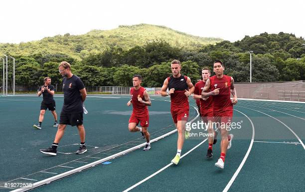 Jurgen Klopp manager of Liverpool with Philippe Coutinho Jordan Henderson Ryan Kent and Roberto Firmino during a training session on July 20 2017 in...