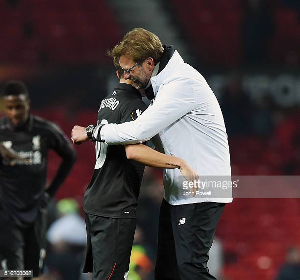 Jurgen Klopp manager of Liverpool with Philippe Coutinho of Liverpool at the end of the UEFA Europa League Round of 16 Second Leg match between...