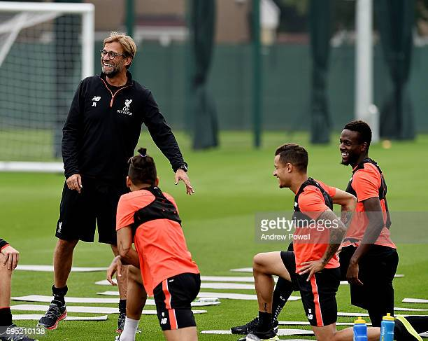 Jurgen Klopp manager of Liverpool with Philippe Coutinho Roberto Firmino and Divock Origi during a training session at Melwood Training Ground on...