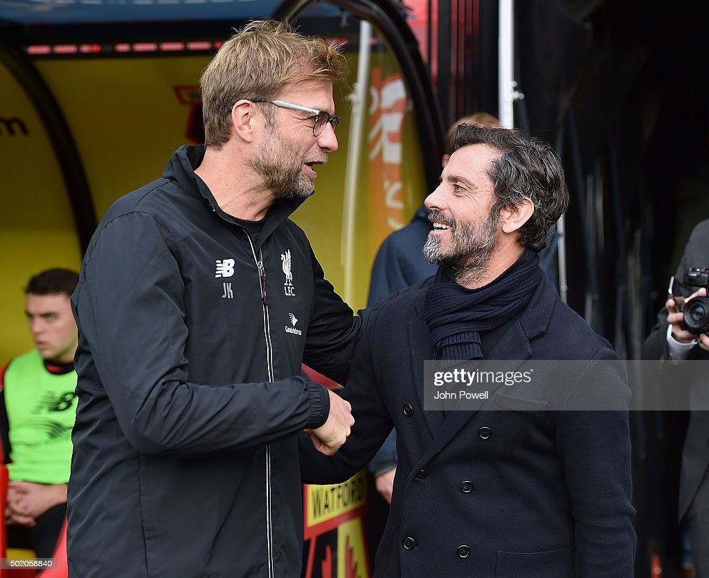 Jurgen Klopp manager of Liverpool with Quique Flores manager of Watford at the start of the Barclays Premier League match between Watford and Liverpool at Vicarage Road on December 20, 2015 in Watford, England.