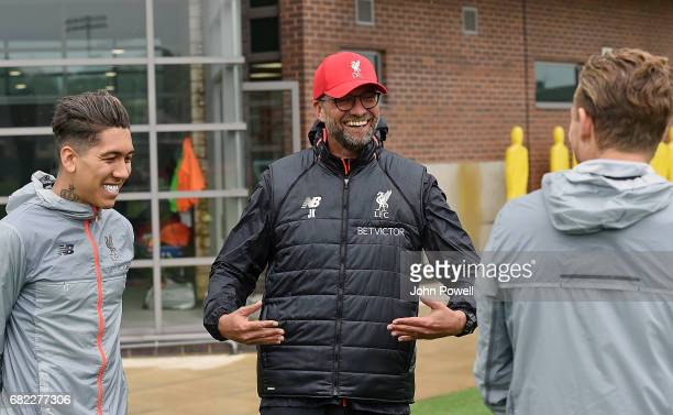 Jurgen Klopp manager of Liverpool with Roberto Firmino and Lucas Leiva during a training session at Melwood Training Ground on May 12 2017 in...