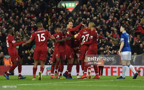 Jurgen Klopp Manager of Liverpool with Roberto Firmino Celebrates at the end of the Premier League match between Liverpool FC and Everton FC at...