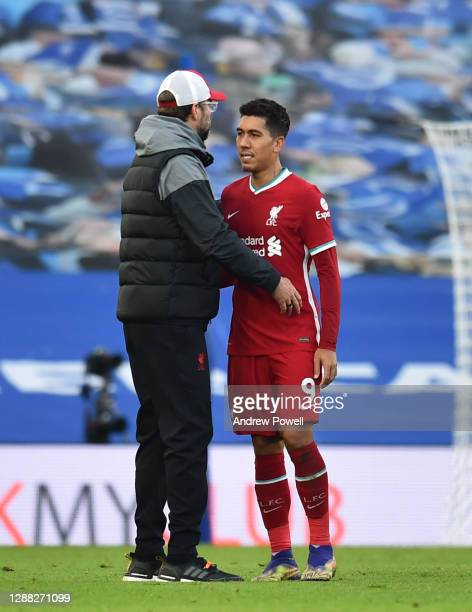Jurgen Klopp manager of Liverpool with Roberto Firmino of Liverpool at the end of the Premier League match between Brighton & Hove Albion and...