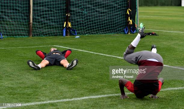 Jurgen Klopp manager of Liverpool with Sadio Mane during a training session on February 12, 2019 in Marbella, Spain.