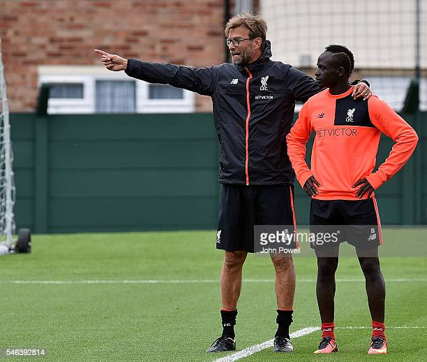 Jurgen Klopp manager of Liverpool with Sadio Mane during a training session at Melwood Training Ground on July 12 2016 in Liverpool England