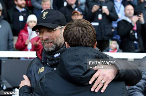Jurgen Klopp Manager of Liverpool with Scott Parkerduring the Premier League match between Fulham FC and Liverpool FC at Craven Cottage on March 17...