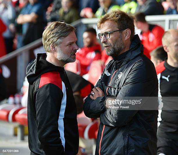 Jurgen Klopp manager of Liverpool with Steven Pressley manger of Fleetwood Town at the start of the PreSeason Friendly match bewteen Fleetwood Town...