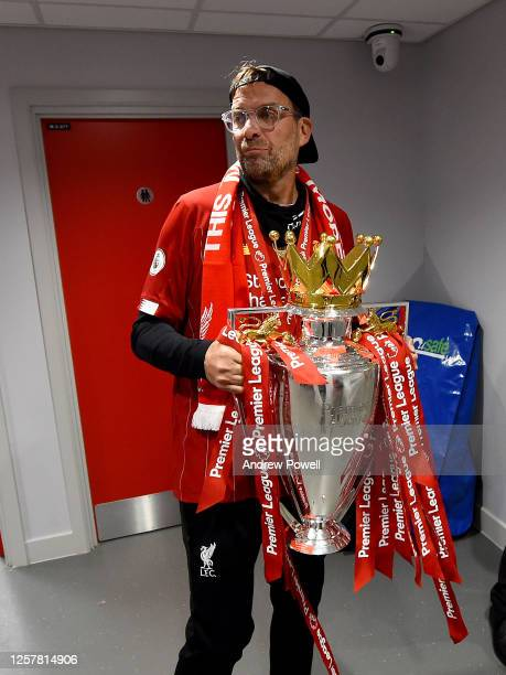 Jurgen Klopp manager of Liverpool with the Premier League trophy in the tunnel at the end of the Premier League match between Liverpool FC and...