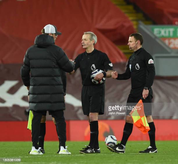 Jurgen Klopp manager of Liverpool with the referee at the end of the Premier League match between Liverpool and Chelsea at Anfield on March 04, 2021...