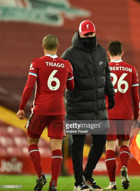 Jurgen Klopp manager of Liverpool with Thiago Alcantara of Liverpool at the end of the Premier League match between Liverpool and Manchester United...