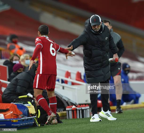 Jurgen Klopp manager of Liverpool with Thiago Alcantara of Liverpool goes off during the Premier League match between Liverpool and Chelsea at...