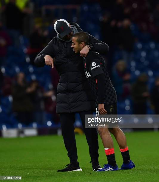 Jurgen Klopp manager of Liverpool with Thiago Alcantara of Liverpool at the end of the Premier League match between Burnley and Liverpool at Turf...