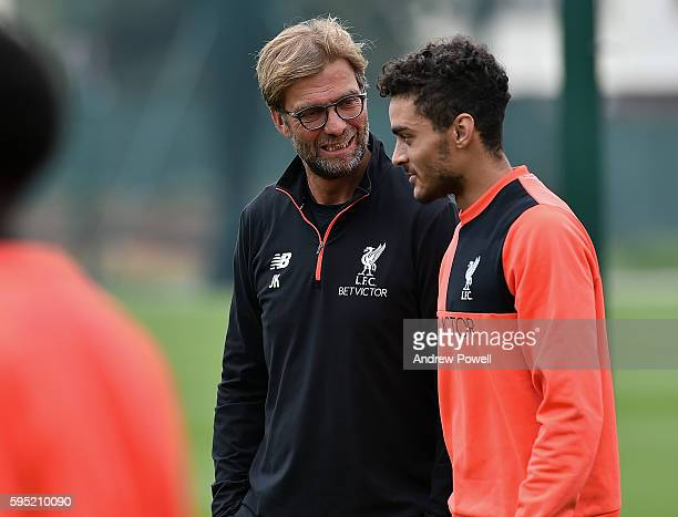 Jurgen Klopp manager of Liverpool with Tiago Ilori during a training session at Melwood Training Ground on August 25 2016 in Liverpool England